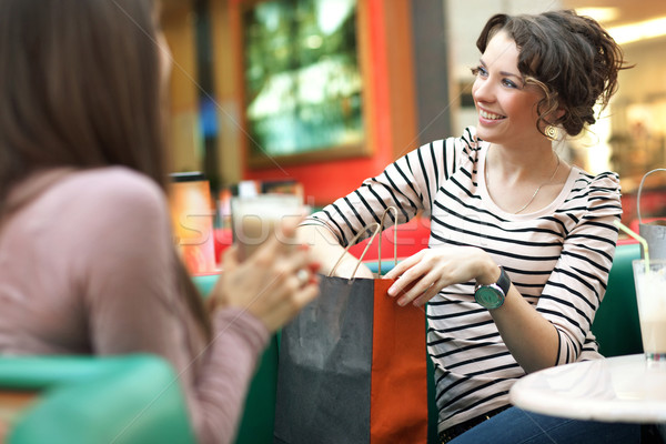 Stunning women after shopping talking with friend Stock photo © konradbak