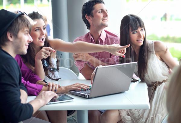 Young people browsing internet on a coffee break Stock photo © konradbak
