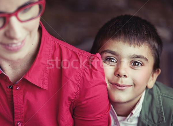 Aranyos fiú nagy barna szemek ölel anya Stock fotó © konradbak