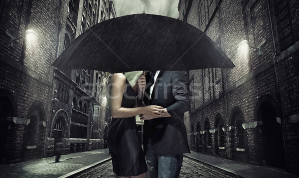 Adorable couple parapluie noir amour homme Photo stock © konradbak
