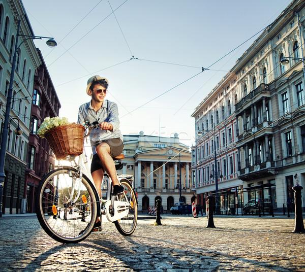 Young elegant man riding a bike Stock photo © konradbak