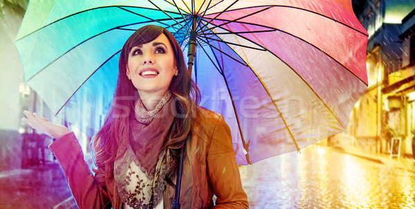 Pretty young brunette enjoying the rainy weather Stock photo © konradbak