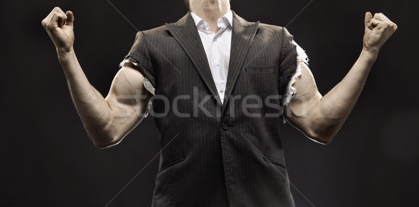Muscular businessman achieving a life success Stock photo © konradbak