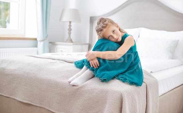 Sad young girl sitting in bedroom Stock photo © konradbak