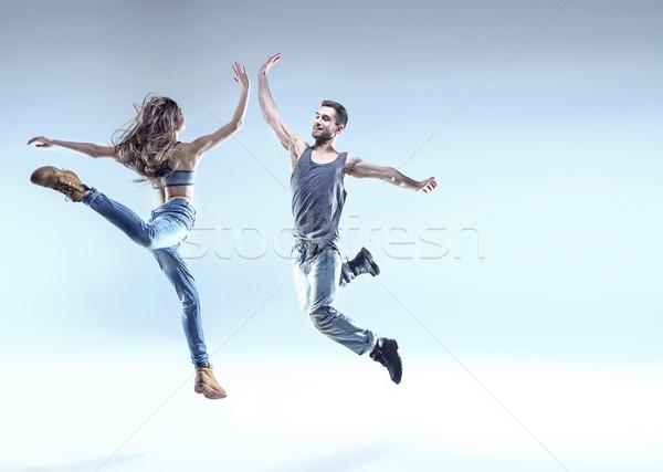 Kettő fiatal táncosok ugrik póz nő Stock fotó © konradbak