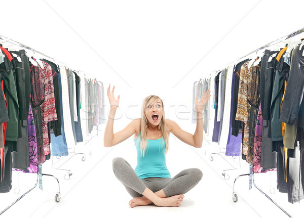 Happy blonde beauty in a wardrobe Stock photo © konradbak