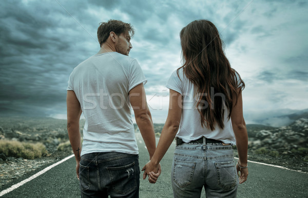 Two hitchhikers walking along the road Stock photo © konradbak