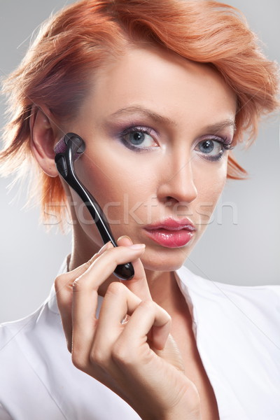 Happy woman caring about her fresh healthy skin of face with der Stock photo © konradbak