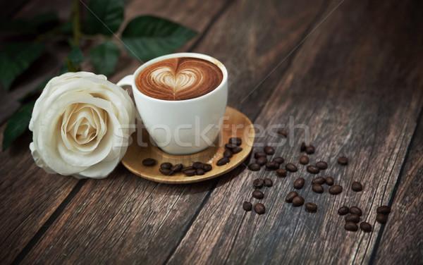 Hot coffee and beautiful white rose Stock photo © konradbak