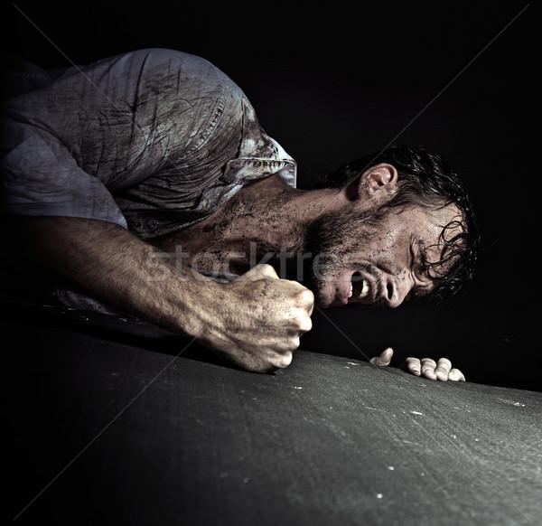 Resigned handsome man hitting the floor Stock photo © konradbak