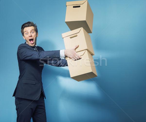 Surprised smart banker with the boxes Stock photo © konradbak
