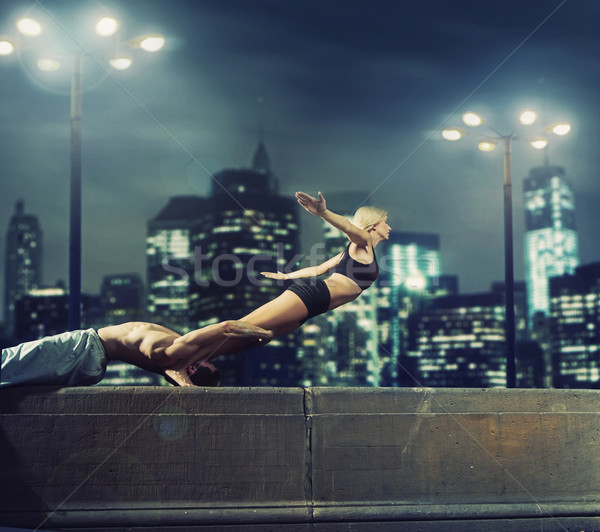 Athletic couple practisin in the evening Stock photo © konradbak