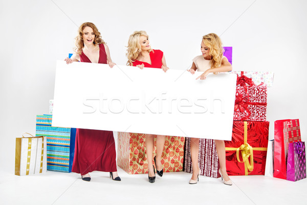 Three attractive women holding empty board Stock photo © konradbak