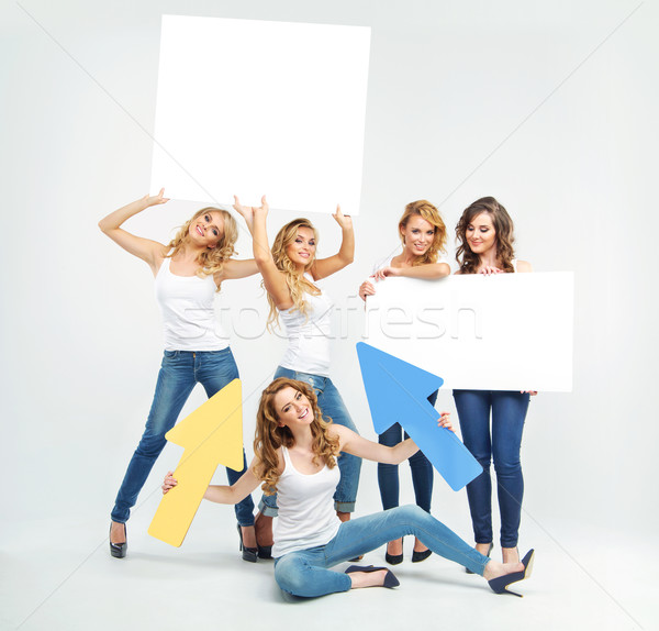 Attractive and cheerful women promoting something Stock photo © konradbak