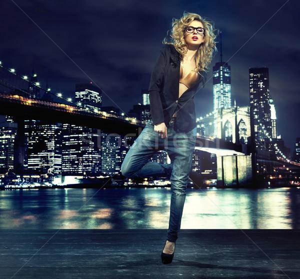Portrait of alluring lady over the night city Stock photo © konradbak