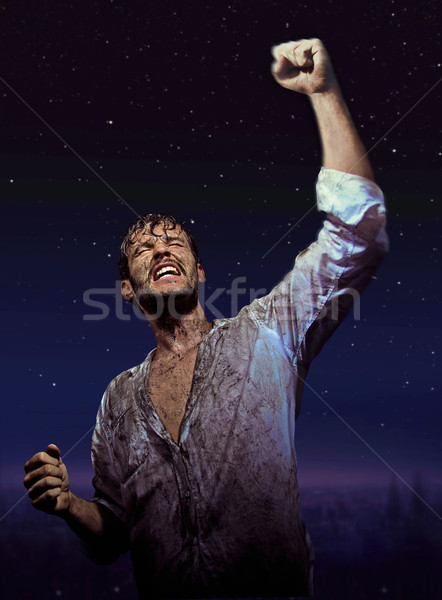 Brave handsome man in glory pose Stock photo © konradbak