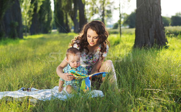 Mother reading fairy tales for the child Stock photo © konradbak