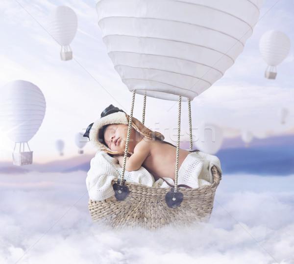 Fantasty image of little boy flying a balloon Stock photo © konradbak