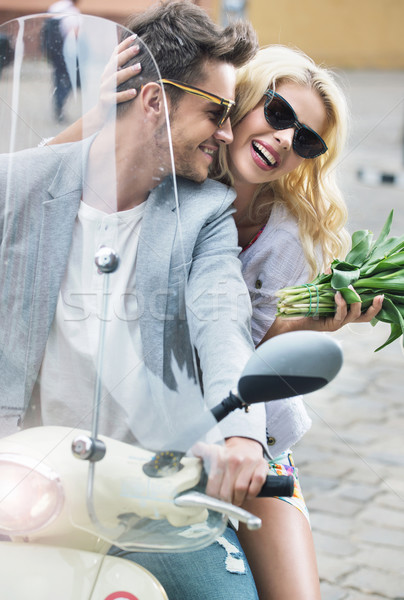 Adorable woman sitting on the scooter with her boyfriend Stock photo © konradbak
