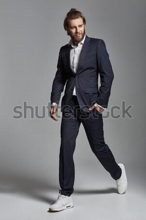 Portrait of a handsome smiling confident businessman  Stock photo © konradbak