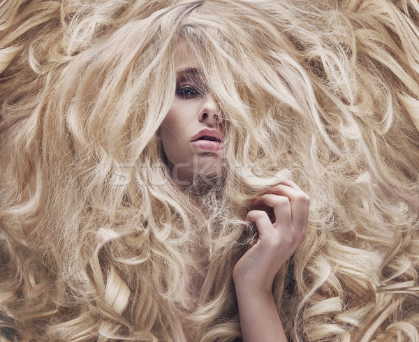 Conceptual photo of a women with lush wig Stock photo © konradbak
