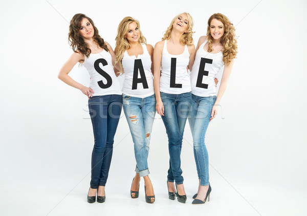 Four attractive women promoting sale Stock photo © konradbak