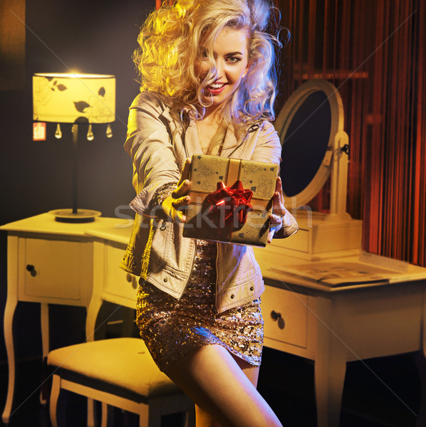 Portrait of an attractive girl with fancy gift Stock photo © konradbak