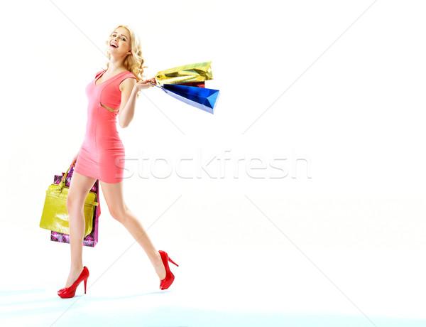 Elragadtatott nő bevásárlótáskák fiatal nő mosoly modell Stock fotó © konradbak