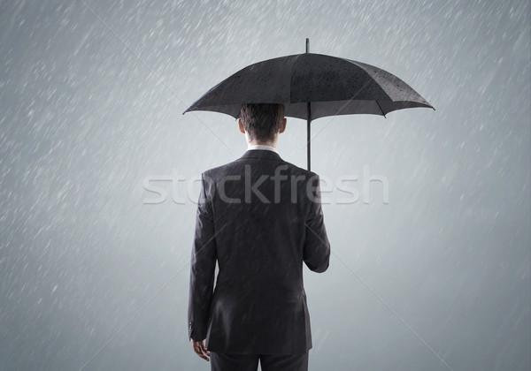 Genç akıllı ayakta yağmur ağır gökyüzü Stok fotoğraf © konradbak