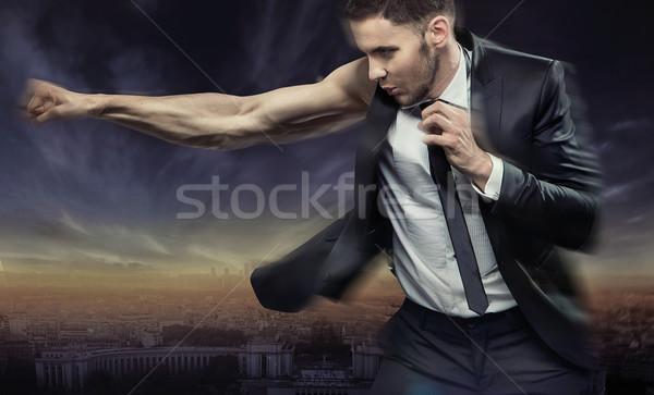 Muscular businessman defeating his issues Stock photo © konradbak