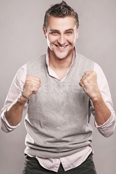 Fiatal boldog üzletember mosoly arc háttér Stock fotó © konradbak