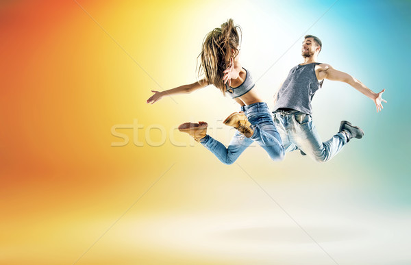 Two young dancers practising in large studio Stock photo © konradbak