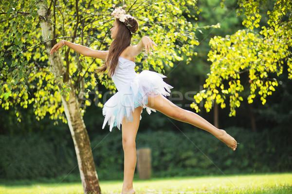 Picture presenting cute dancing young nymph Stock photo © konradbak