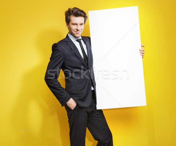 Handsome gentleman carrying white board Stock photo © konradbak