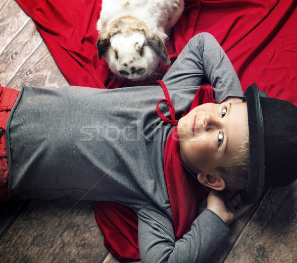 Portrait of a happy little magician boy Stock photo © konradbak