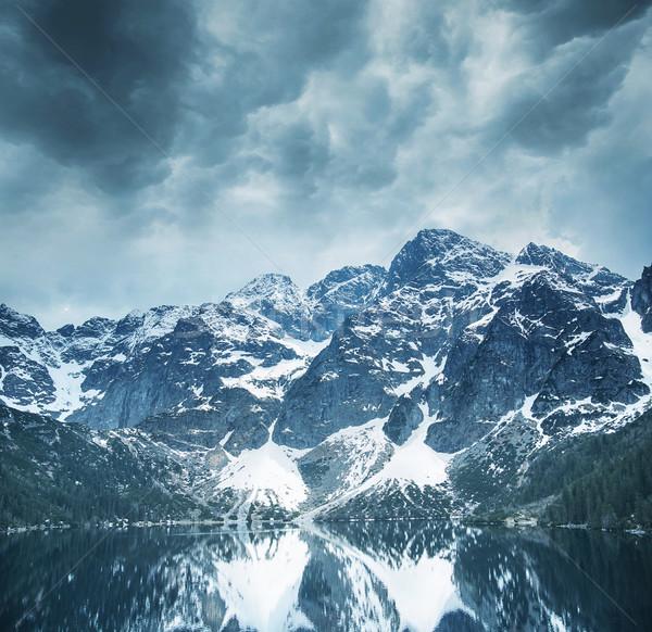 Beautiful landscape of majestic mountains and a clear lake Stock photo © konradbak
