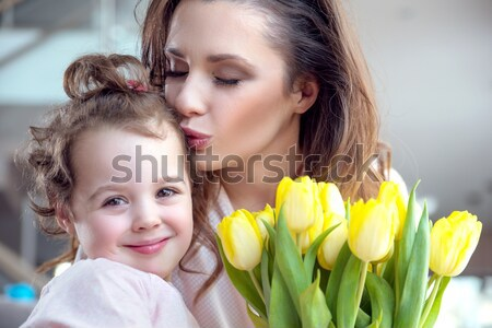 Two flower nymphs and a bunch of tulips Stock photo © konradbak