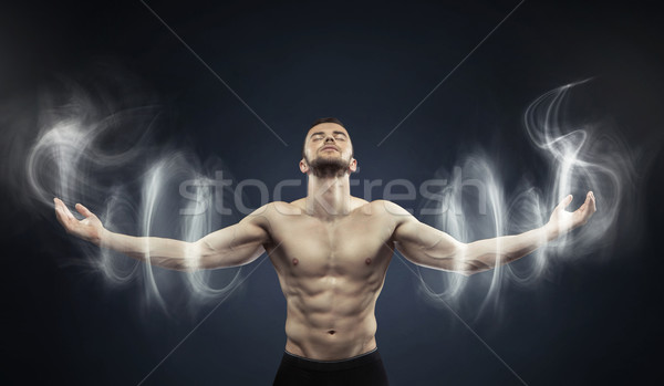 Powerful man meditating in peaceful place Stock photo © konradbak