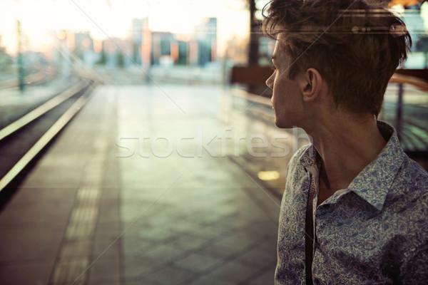 Calm guy in the railway station Stock photo © konradbak