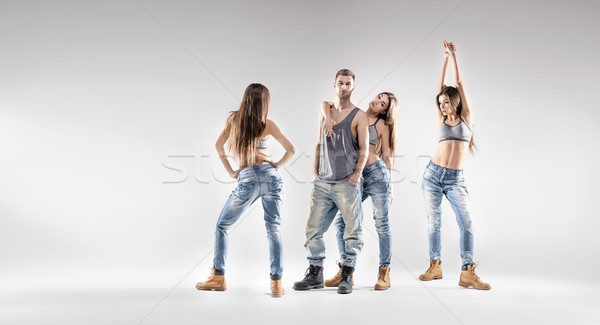 Handsome dancer with pretty ladies Stock photo © konradbak