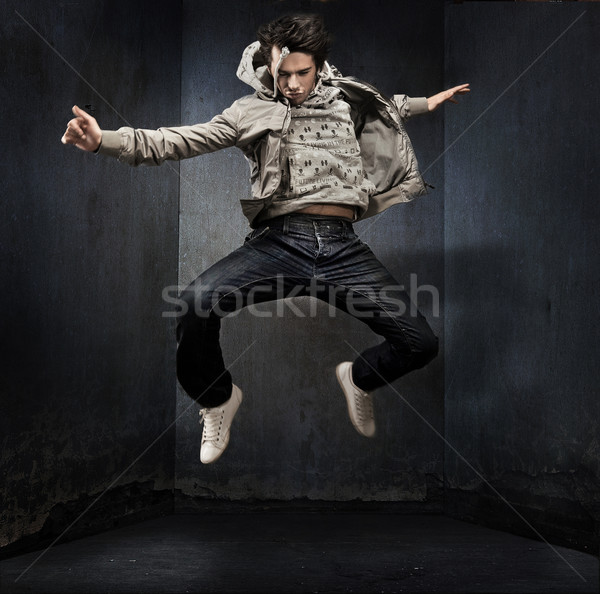 Young hip-hop dancer over a grunge wall Stock photo © konradbak