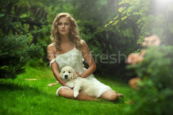 Cute young lady holding a puppy dog Stock photo © konradbak