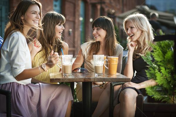 Attractive women enjoying meeting Stock photo © konradbak
