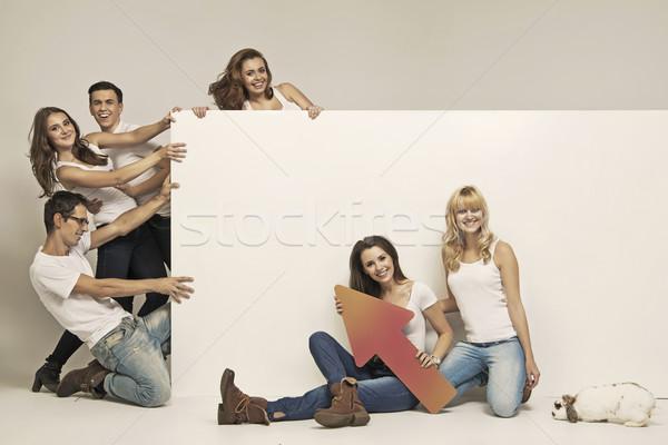Funny photo of people pulling white board Stock photo © konradbak