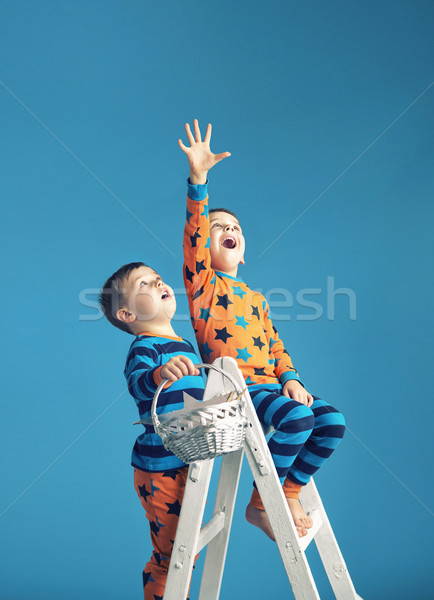 Little men on a ladder to the dream Stock photo © konradbak