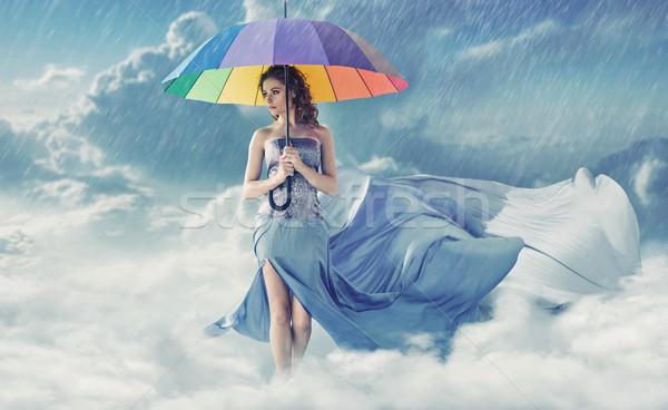 Mooie jonge dame regenachtig weer jonge vrouw Stockfoto © konradbak