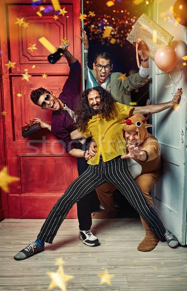 Portrait of funny guys on the party Stock photo © konradbak