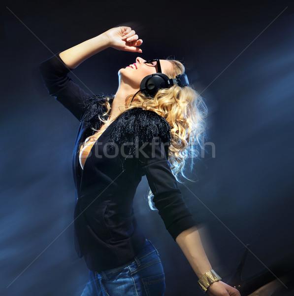 Szőke nő hölgy élvezi zene rockzene nő Stock fotó © konradbak