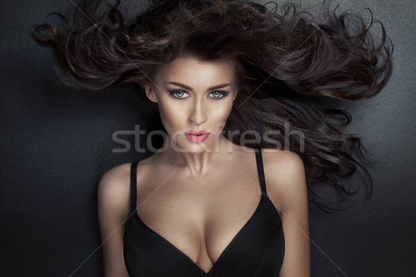 Alluring lady looking at the camera Stock photo © konradbak