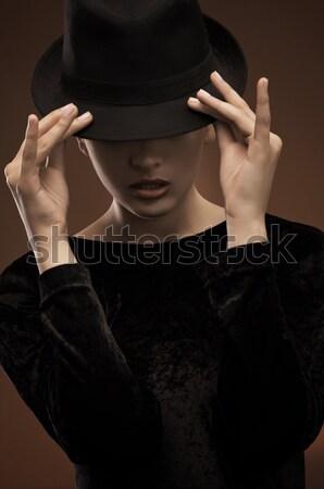 Stock photo: Attractive brunette wearing hat